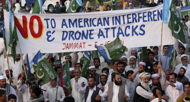 Supporters of a Pakistani religious party Jamaat-e- Islami arrive to join a rally against the U.S. drone strikes in Pakistani tribal areas, Saturday, April 23, 2011, in Peshawar, Pakistan.  Pakistan stopped NATO supplies from traveling to Afghanistan on Saturday as thousands of protesters rallied on the main road leading to the border, demanding that U.S. Washington stop firing missiles against militants sheltering inside the country. (AP Photo/Mohammad Sajjad)