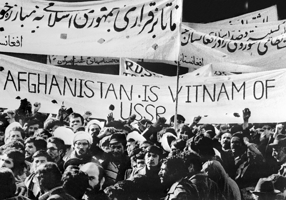 Afghan students protest in Tehran 01 January 1980 against Soviet military invasion in Afghanistan in Kabul. Protesters attacked Soviet embassy before and pulled down the flag to pull up their own. AFP PHOTO/UPI (Photo credit should read /AFP/Getty Images)